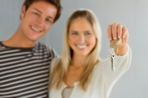 couple holding the keys to their first home