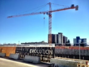 Evolution condos construction crane East Village Calgary
