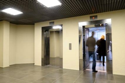 People entering into a condo elevator