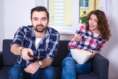 couple watching movie popcorn couch best date ideas calgary alberta